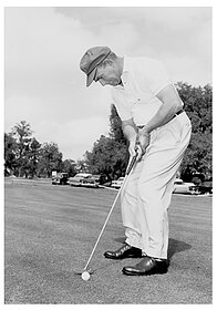 man golfing during early days at Capitol City CC